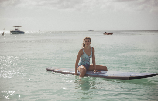 girl on surfboard in the sea