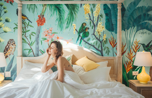 Woman in bed of a coco casita