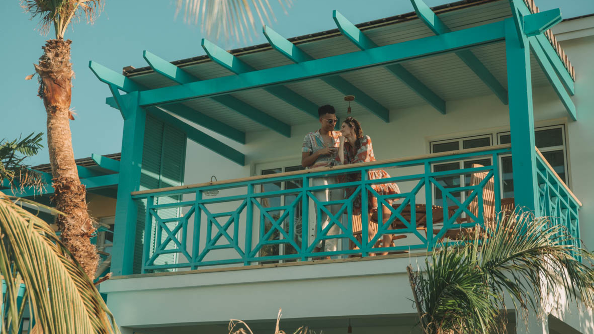 couple on balcony of casita