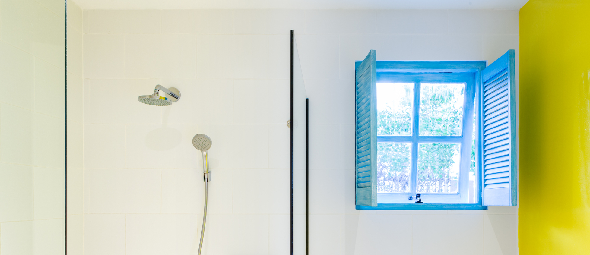 bathroom with rain shower in one bedroom casita