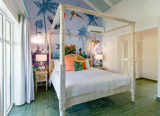 Bedroom with exotic painted mural